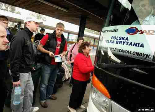 Polish jobseekers boarding buses to the UK (Getty)