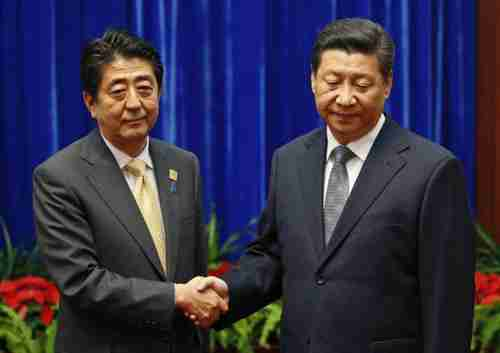 Ice cold handshake Monday between Xi Jinping and Shinzo Abe