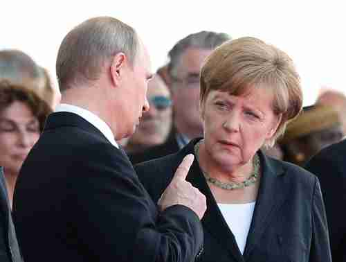 Putin wags his finger at Merkel at the 70th anniversary of D-Day commemoration in June (Reuters)