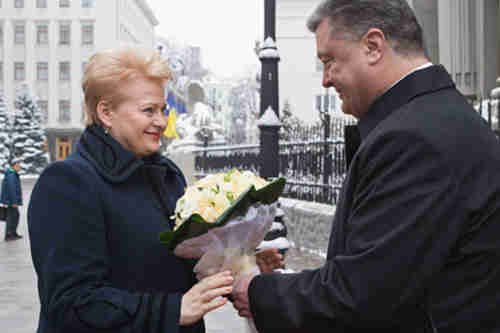 Ukraine's president Petro Poroshenko, right, greets Lithuania's president Dalia Grybauskaite in Kiev on Monday (AP)
