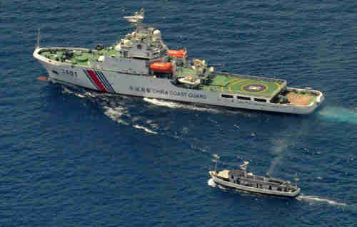 Philippine troop and Chinese maritime police boat confrontation at Second Thomas Reef.
