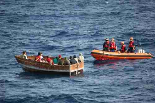 Coast Guard approaches a Cuban vessel with 12 migrants on December 30.  The migrants were later repatriated to Cuba