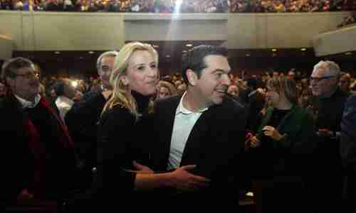 Syriza leader Alexis Tsipras dances with party official Rena Dourou at pre-election rally last month (EPA)