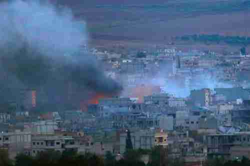 A fire burns in Kobani Syria during heavy fighting between ISIS and Kurdish Peshmerga forces (Reuters)