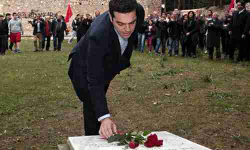 Alexis Tsipras places flowers on the National Resistance Memorial in Kaisariani on Monday. (EPA)