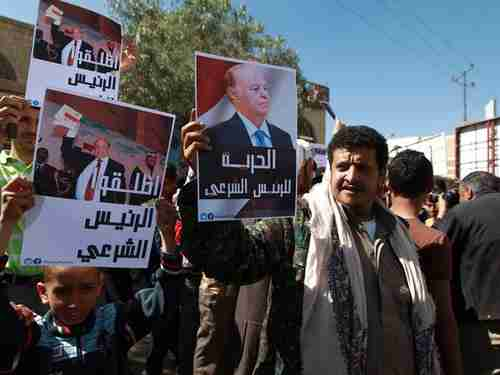 Anti-Houthi demonstrations in Sanaa on Saturday.  The posters have pictures of Hadi (AFP)