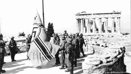 Nazi soldiers raising the swastika flag on the Acropolis