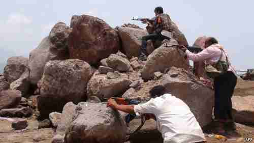 Pro-Hadi fighters in Aden holding a position during clashes with Houthis on Saturday (AFP)