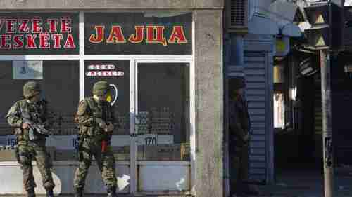 Macedonian special units take cover near battle zone in Kumanovo (AP)