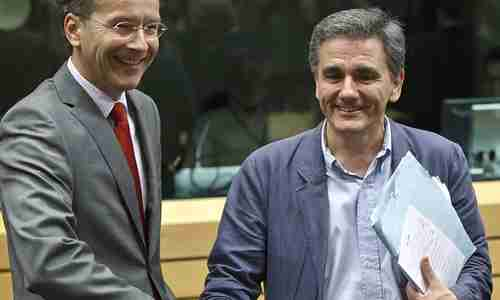 Euclid Tsakalotos (R) exposes his personal notes to cameras, where they can be photographed and examined (AP)