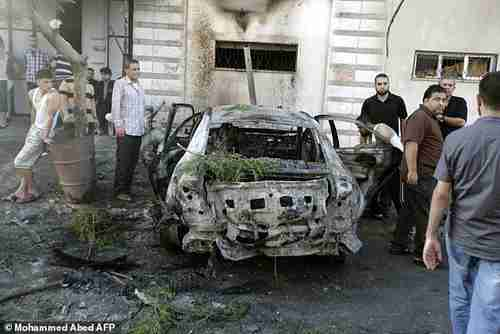One of five cars in Gaza blown up by explosions in Gaza early Sunday morning (AFP)