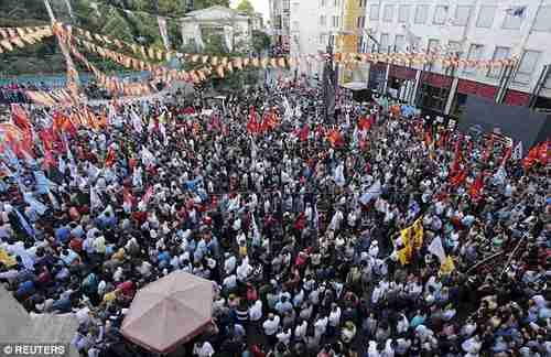 Anti-Erdogan demonstrators in Taksim Square in Istanbul on Monday (Reuters)