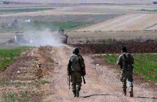 Turkish soldiers patrol near the border with Syria on Friday (AP)