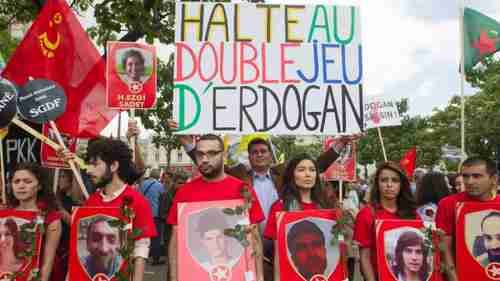 Protesters in Paris carrying a banner saying, 'Stop Erdogan's double game' (AP)