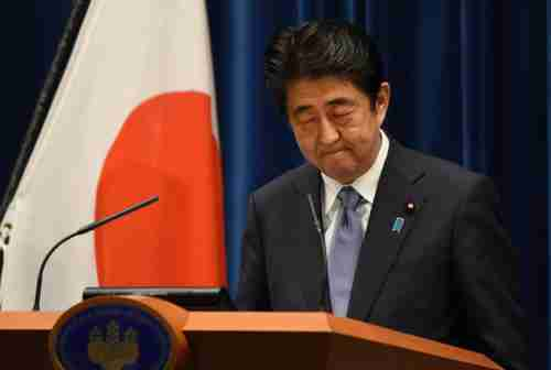Shinzo Abe looks down during his speech on Friday (Getty)