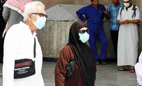 Pilgrims attending last year's Hajj wore nose and mouth masks (AFP)