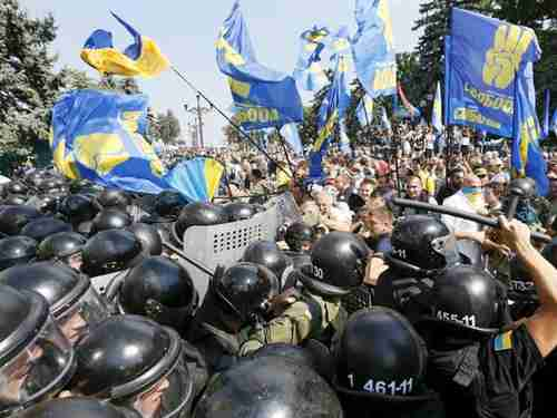 Demonstrators clash with police outside the Parliament in Kiev, Ukraine, on Monday (Reuters)