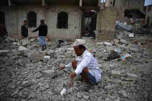 A man inspects the rubble of a house destroyed by a Saudi airstrike in Sanaa on Monday (AP)