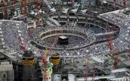 Aerial view of thousands of Muslim worshippers in the Grand Mosque in July, surrounded by construction cranes.  The rectangular building at the center is the Kabaa, the holiest shrine in Islam. (Telegraph)