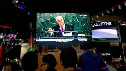 Palestinians in Ramallah, West Bank, watch Abbas's UN speech on Wednesday (AP)