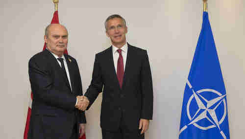 NATO Secretary General Jens Stoltenberg (R) expressing solidarity with Minister of Foreign Affairs of Turkey, Feridun Sinirlioglu, in Brussels on Monday