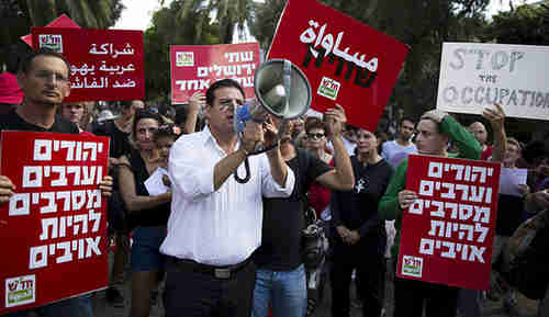 Ayman Odeh (center) leading an October 9 rally in Tel Aviv (Reuters)