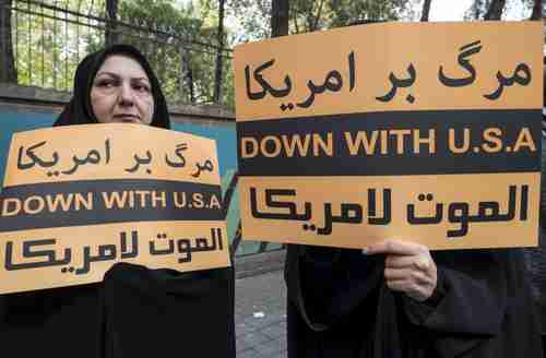 Women hold anti-U.S.  banners commemorating Iran's 1979 attack on the U.S. embassy in Tehran (Reuters)