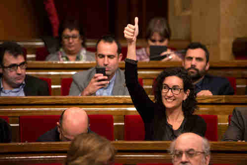 Marta Rovira votes for secession from Spain in Catalonia's parliament on Monday (Getty)