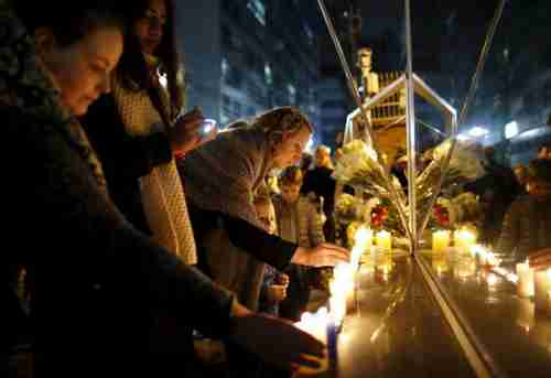 French people in Seoul, South Korea, light candles to pay tribute to the victims of the Paris attacks (Reuters)