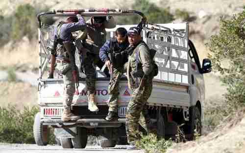 Syrian Turkmen fighters near border with Turkey last week (Reuters)
