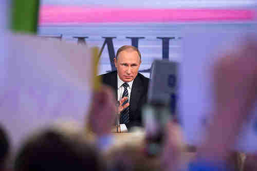 Putin at his tv call-in marathon on Thursday (AP)