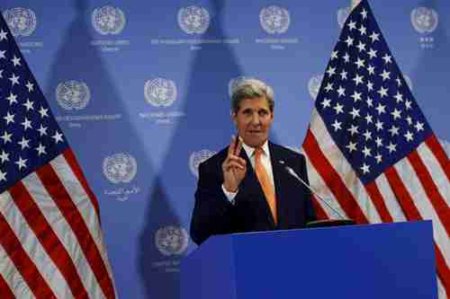 Vietnam anti-American antiwar protester John Kerry gives the 1960s 'peace sign' at a United Nations news conference in Vienna last week (Reuters)