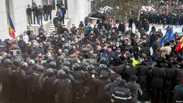 Hundreds of protesters broke through police lines on Wednesday to get into Moldova's parliament on January 20 (Reuters)