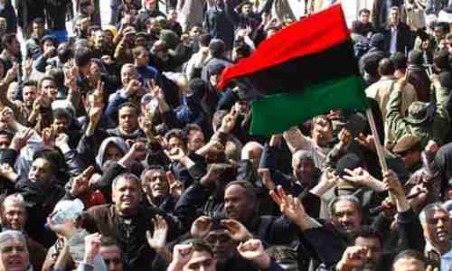 A 14-Mar-2011 picture in the Guardian of Libyan protesters, with the caption, 'Even if Gaddafi does succeed in quelling the Libyan uprising, it will be no more than a temporary setback for the wider Arab revolution.' (Reuters)