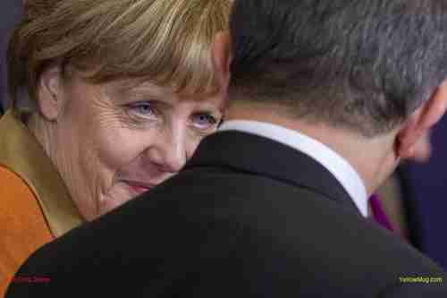 German Chancellor Angela Merkel talks with Turkish Prime Minister Ahmet Davutoglu in Brussels, on Monday
