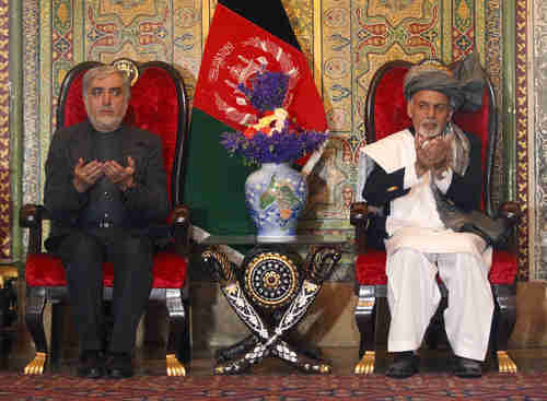 Unity government leaders President Ashraf Ghani, right, and Chief Executive Abdullah Abdullah (Reuters)