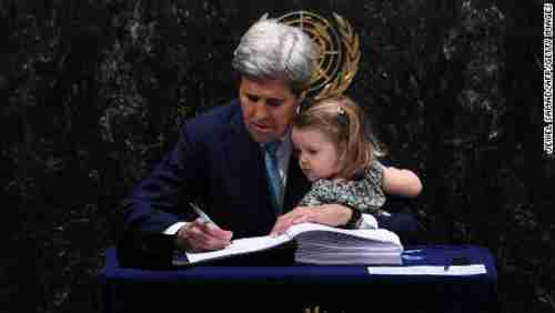 John Kerry and his granddaughter sign the climate change agreement