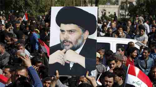 A demonstrator holds a picture of Moqtada al-Sadr during a demonstration in Baghdad (Reuters)