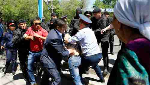 Riot police confront protesters on Saturday in Almaty, Kazakhstan's largest city (Reuters)