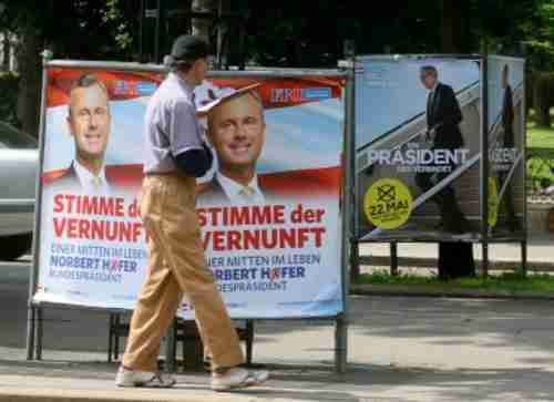 Election posters for Norbert Hofer (L) and Alexander van der Bellen. (AP)