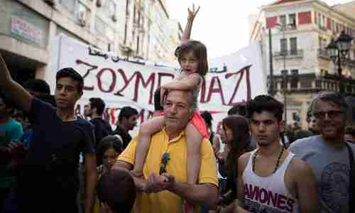 People demonstrate in support of refugees in Athens on Thursday (Guardian)