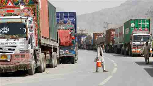 Hundreds of trucks backed up at the Torkham border crossing between Pakistan and Afghanistan (Reuters)