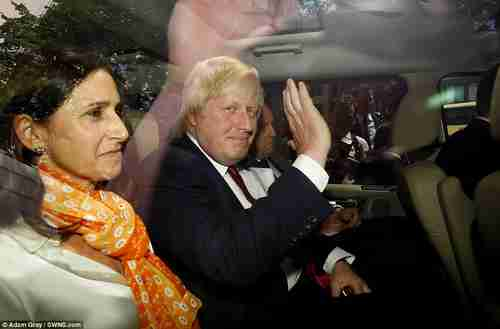 Boris Johnson, next to his wife Marina, waves goodbye on Thursday after standing down (Daily Mail)