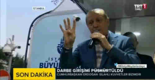 Screen grab from video of Erdogan's speech on Saturday in which he gives the four-finger R4BIA salute