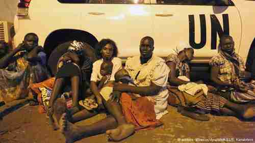 South Sudan refugee women and children seek shelter under a UN van. (DPA)