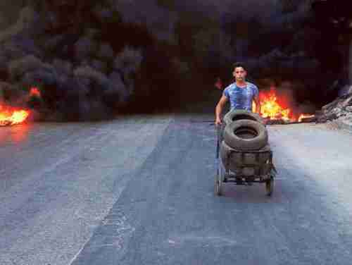 Burning tires in Aleppo to create a 'no-fly zone' (AP)
