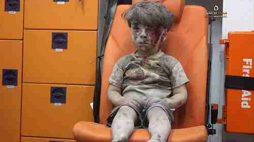 Five year old boy, Omran Daqneesh, sitting confused in an ambulance in Aleppo after being pulled from the rubble of one of Bashar al-Assad's airstrikes.  To al-Assad, this boy and others like him are just cockroaches to be exterminated.