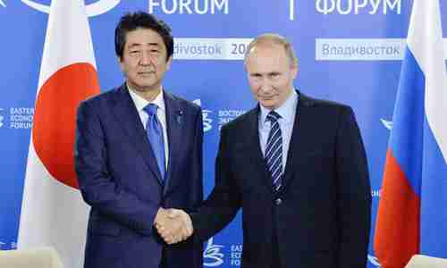 Shinzo Abe and Vladimir Putin on Friday