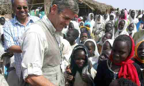 Celebrity star George Clooney visiting a Darfur refugee camp in 2008 (AP)