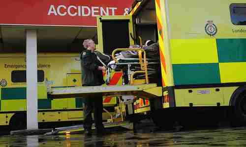 A patient in Britain is moved from an ambulance to an Accident & Emergency department. (Getty)